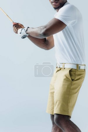Photo for Cropped view of african american sportsman playing golf isolated on grey - Royalty Free Image