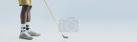 Photo for Partial view of african american sportsman playing golf on grey background, panoramic shot - Royalty Free Image