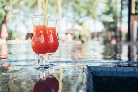 two glasses with natural, delicious refreshing beverage at poolside