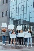"Постер, картина, фотообои ""emotional multicultural group of people with blank placards near building """