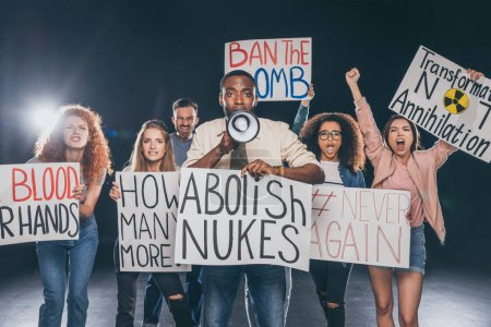 emotional multicultural men and women holding placards with lettering on black