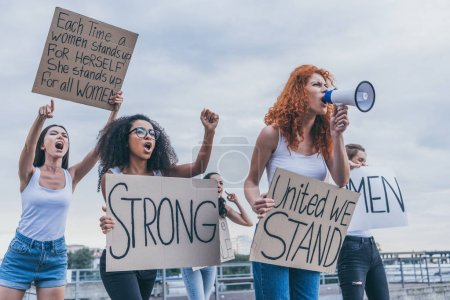 Photo for Multicultural girls holding placards and screaming outside - Royalty Free Image