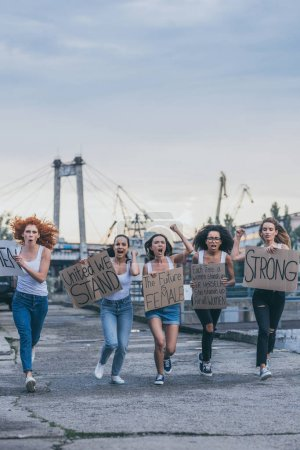 Photo for Multicultural women holding placards and running outside - Royalty Free Image