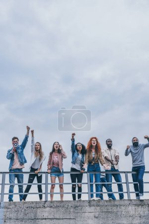Photo for Multicultural men and women gesturing and screaming outside - Royalty Free Image