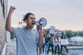 "Постер, картина, фотообои ""selective focus of african american man screaming while holding megaphone """