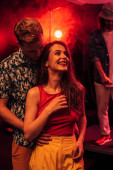 """Постер, картина, фотообои """"man and smiling young woman during rave party in nightclub"""""""