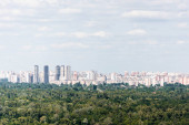 "Постер, картина, фотообои ""Urban scene with trees in city park, skyscrapers and buildings """