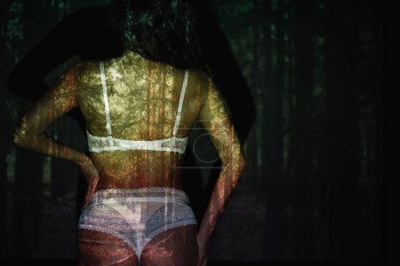 Photo for Back view of sexy woman standing in lace white lingerie near trees - Royalty Free Image