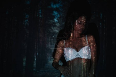 Photo for Sexy girl standing in lace white underwear near trees - Royalty Free Image