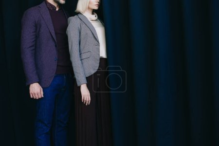 Photo for Cropped view of elegant young woman and man near curtain - Royalty Free Image