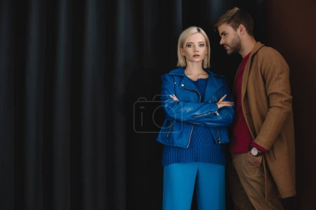 Photo for Stylish couple in autumn outfits standing near curtain - Royalty Free Image