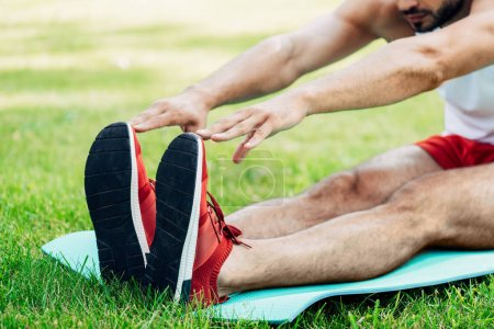 Photo for Cropped view of man doing stretching exercise - Royalty Free Image