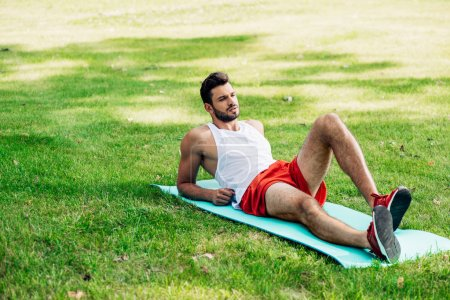 Photo for Handsome sportsman lying on fitness man in park - Royalty Free Image