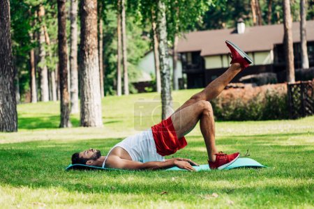 Photo for Athletic sportsman working out on fitness mat outside - Royalty Free Image
