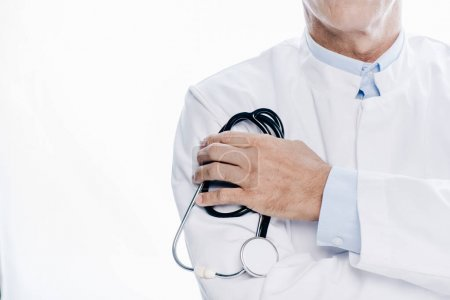 Photo for Cropped view of doctor in white coat holding stethoscope isolated on white - Royalty Free Image