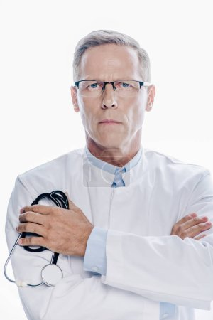 Photo for Handsome doctor in white coat holding stethoscope isolated on white - Royalty Free Image
