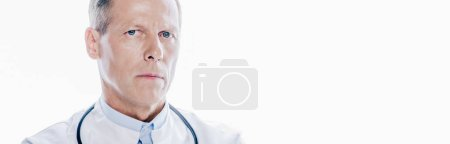 Photo for Panoramic shot of handsome doctor in white coat looking at camera isolated on white - Royalty Free Image