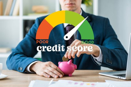 Photo for Cropped view of businessman putting metallic coin into piggy bank near speed meter and credit score letters - Royalty Free Image