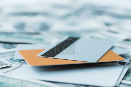 Photo for Selective focus of pile with credit cards on dollar banknotes - Royalty Free Image