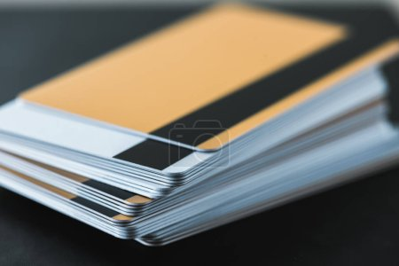 Photo for Close up of stack with credit cards on black - Royalty Free Image
