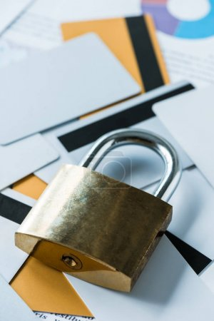 Photo for Close up of metallic padlock near credit cards - Royalty Free Image