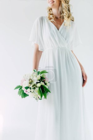 Photo for Cropped view of bride in wedding dress holding bouquet isolated on white - Royalty Free Image