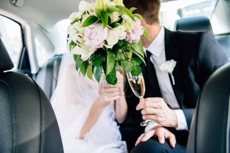 Photo for Selective focus of bridegroom in suit and bride holding bouquet - Royalty Free Image