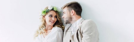 Photo for Panoramic shot of attractive bride and handsome bridegroom smiling and looking at each other - Royalty Free Image