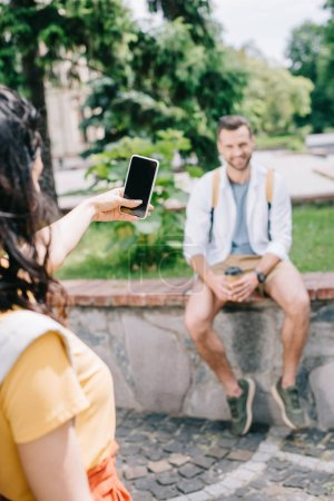 Photo for Selective focus of woman holding smartphone with blank screen near man - Royalty Free Image
