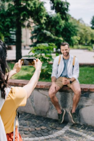 Photo for Cropped view of girl holding smartphone with blank screen near happy man - Royalty Free Image
