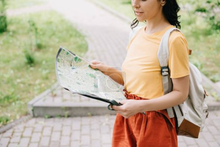 Photo for Cropped view of woman holding map while standing outside - Royalty Free Image