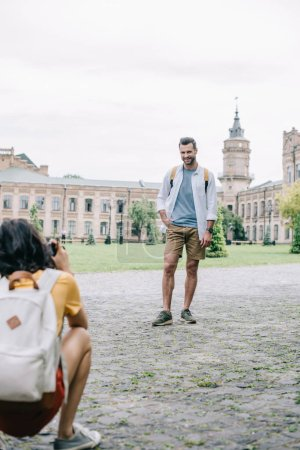 Photo for Selective focus of happy man standing near girl taking photo - Royalty Free Image