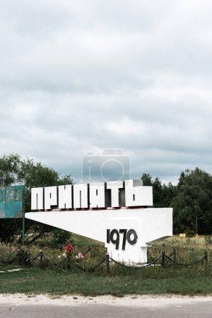 Photo for PRIPYAT, UKRAINE - AUGUST 15, 2019: monument with pripyat lettering near trees outside - Royalty Free Image