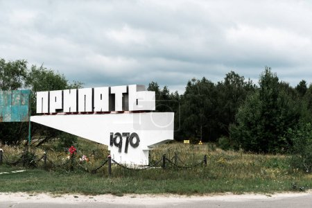 Photo for PRIPYAT, UKRAINE - AUGUST 15, 2019: monument with pripyat letters near trees outside - Royalty Free Image