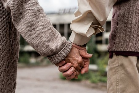 Photo for Cropped view of retired man and woman holding hands - Royalty Free Image