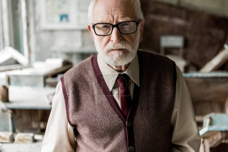 Photo for Bearded retired man in glasses looking at camera - Royalty Free Image