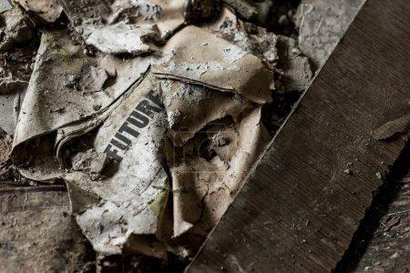 Photo pour Journal brûlé avec le lettrage futur sur le plancher sale - image libre de droit