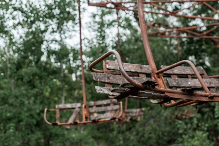 Photo for Selective focus of rusty red carousel in amusement park in chernobyl - Royalty Free Image