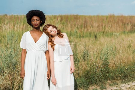 Photo for Young and attractive multicultural women standing in field - Royalty Free Image