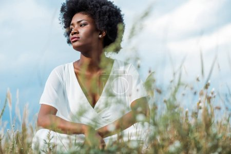selective focus of attractive african american woman in white dress