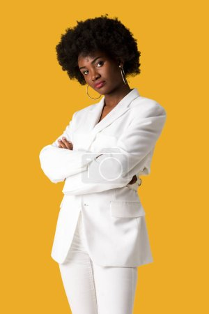 Photo for Pretty african american girl standing with crossed arms isolated on orange - Royalty Free Image