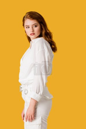 Photo for Beautiful and young redhead woman isolated on orange - Royalty Free Image