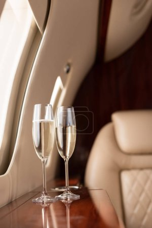 Photo for Interior of plane with champagne glasses for trip - Royalty Free Image