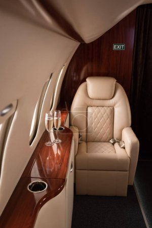 Photo for Empty aircraft with glasses of champagne for trip - Royalty Free Image