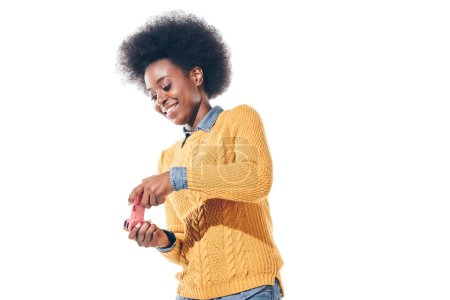 cheerful african american girl playing video game with joystick, isolated on white