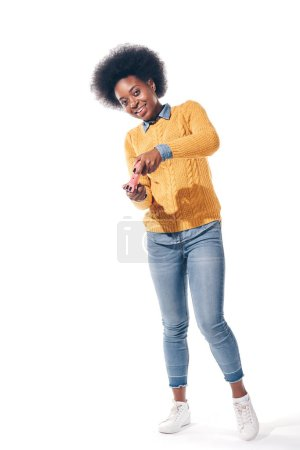 happy african american woman playing video game with joystick, isolated on white