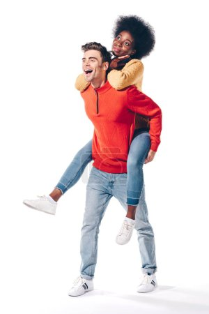 Photo for Happy boyfriend piggybacking his african american girlfriend, isolated on white - Royalty Free Image