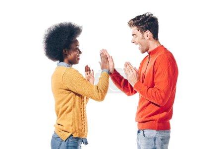 Photo pour Beau couple multiculturel en vêtements d'hiver donnant plus de cinq, isolé sur blanc - image libre de droit