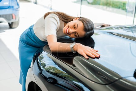 Photo for Selective focus of happy woman with closed eyes near black car - Royalty Free Image