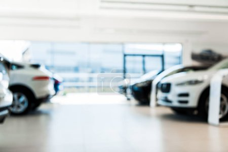 Photo for Blurred car showroom with new and luxury cars - Royalty Free Image
